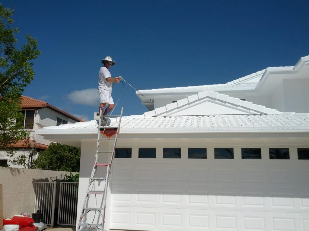 Painting a cool roof