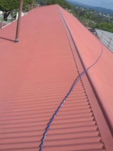 School roof before cool roof painting